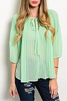 """Mint pleated top with bow tie neck detail.  Wear with skinny dark denim and heels.  L: 25"""" B: 46"""" W: 50""""   Mint Bow Blouse by RolyPoly. Clothing - Tops Colorado"""
