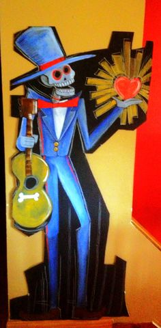 Hand painted on cardboard for a dia de Los muertos party at a local library by Jim DuVal