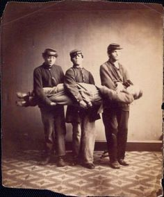 ca. 1861-72, soldiers demonstrating the correct method to carry an injured soldier, U.S. Sanitary Commission