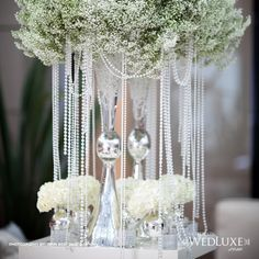 stunning tall vases topped with clouds of baby's breath, dripping in pearls