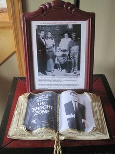 Twilight Zone Tower of Terror prop. Picture of guests on elevator and Twilight Zone book
