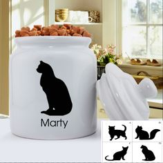 """http://www.theoldcornerstore.com/store/p112/Personalized_Classic_Silhouette_Cat_Treat_Jar_-_Atilla.html  Personalized Classic Silhouette Cat Treat Jar - Atilla  Pet gifts, Kitty Décor, Gifts for your Cat  Any cat lover you know is sure to adore our Personalized Classic Silhouette Cat Treat Jar. Choose from 4 different cat silhouettes. Makes this item a great gift.  MEASUREMENTS: 6""""round x 8 1/4"""" high.  Choose from 4 silhouettes PERSONALIZATION: 1 line up to 15 characters."""