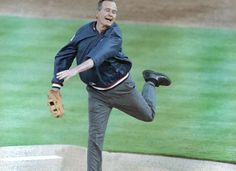 President George H.W. Bush throws out the first pitch at a Texas Rangers' opening night game in 1991, Arlington, Texas.