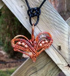 Copper heart with wire woven wrapping,  torch painted finish.