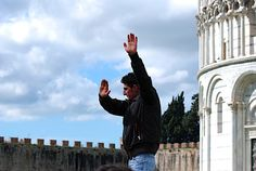 People holding up the leaning tower (from a different perspective)