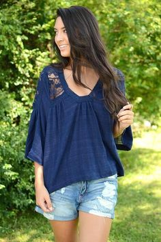 Navy blue is such a classic color and the boho vibes adorned on this beauty are absolutely to.die.for. We absolutely love the lace cut out detailing featured on the flowy silhouette. And if that was n