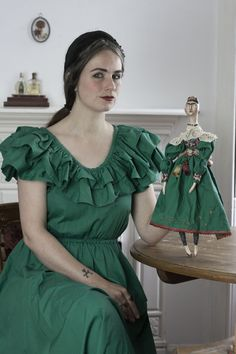 This is a Frida art doll, especially made for my mothers 60th birthday, as she is a huge Frida Kahlo fan. I made this doll with cloth and clay, and the dress is made with the fabric of the s…