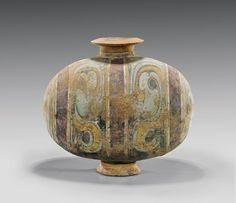 "HAN DYNASTY POTTERY COCOON VASE elaborately painted in unusual pastel color scheme, with patterned bands and swirled motifs; the egg-form with wide flared rim and splayed foot; L: 12 1/2"";"