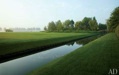 narrow moat at an estate in the countryside of Belgium.