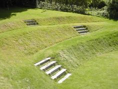 A steeply sloping site provided a great opportunity to create a unique 'amphitheatre' effect to the upper #lawns.
