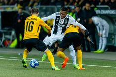 Christian Fassnacht of Young Boys, Kevin Mbabu of Young Boys and Alex. December 12, Uefa Champions League, Bern, Young Boys, Sandro, Switzerland, Battle, Christian, Group