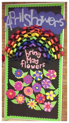 April Showers Bring May Flowers - spring kindergarten bulletin board