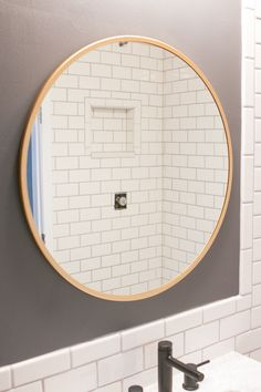 Gold mirror from Lowe's Home Improvement. Here's a video tutorial showcasing how to hang a bathroom mirror. It isn't difficult to hang a mirror into drywall. All you need is an anchor and a screw. #bathroom #goldmirror #mirror #howto #videotutorial