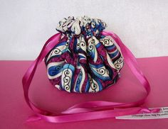 """Individual compartments inside this colorful bag will separate and protect your jewelry.  We sell 5 sizes of bags in over 300 colors.  Bag shown:  """"Pinwheel Doodles"""" $9.50 @IslandJewelryBags.etsy.com #Jewelry Bag"""