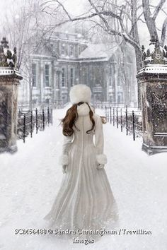 Trevillion Images - woman-wearing-velvet-white-gown-and-fur-walking