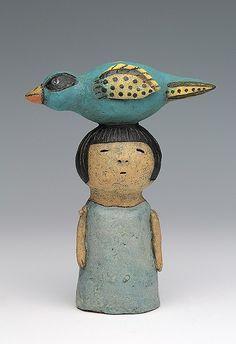 ceramic figure with bird by Sara Swink