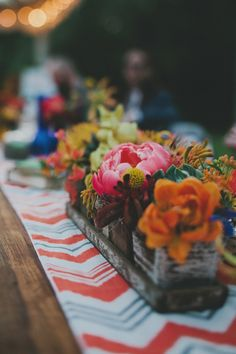 patterned table runner with boxed centerpiece, photo by Red White and Green Photography http://ruffledblog.com/magnolia-plantation-wedding #weddingcenterpieces
