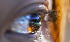 """Woman's eye - """"Kanas, a beautiful place in Xinjiang Uygur Autonomous Regions of China, is a paradise made by nature"""" reflected in a woman's eye. - photo and caption by Shihan Wang / National Geographic Photo Contest 2013"""