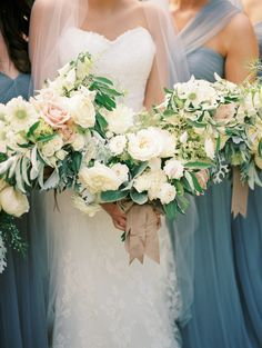 blush blue bridesmaids gowns + white bouquets with greenery