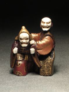 Title: 2 Noh Dancers                                           19th century, Meiji period,                             Signed Issai,                                                                4 cm high,                                                            *Noh is a major form of classical Japanese musical drama that has been performed since the 14th century.