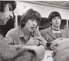 29th August 1966. Ringo, George and Paul (plus Joan Baez and her sister Mimi) doodling on a tablecloth provided by Simpson's Catering of San Francisco.