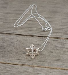 The ancient symbol of the Merkaba in 925 Sterling Silver. The symbol is also called Flower of Life and is believed to be a connecting force to higher spiritual realms. The shape also has significance according to Kabbalah teachings.  ★ What Is The MERKABA? Without diving into energy fields, Prana or Chi, the name Merkaba breaks into Mer = Light, Ka = Spirit and Ba = Body. The Merkaba appears in the Old Testament, Kabbalah and even Tarot cards. The Merkaba balances the activitie...