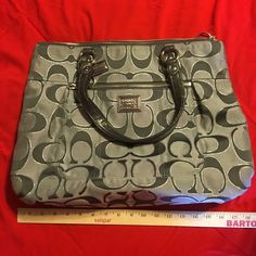 💯 Authentic Silver Coach Purse Beautiful authentic Coach purse. Gray/silver color. Excellent condition! Inside pockets & zipper (see pics).  No rips,stains or tears. Looks new. Coach Bags Shoulder Bags