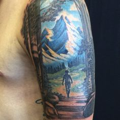 Finished up the mountain path of life tattoo!  The boy is leaving a black and grey forest into the big color world, kind of like Wizard of Oz. #tattoo #bobross #mountain #journey #inspiration #vintagekarma #ainslieheilich #tuscola #ihearttuscola #realistictattoo #fantasytattoo #treetattoo #mountaintattoo #champaign #urbana #chambana #illinoistattoo #tattoosnob