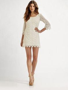 I want a white, lace dress so bad...I probably will NOT be purchasing this $285 one though...even though it sure is pretty...