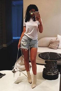 Kylie Jenner wearing Christian Louboutin Tucson Booties, One Teaspoon Diamonde Chargers Shorts and Victoria Beckham Classic Victoria Sunglasses in Dune