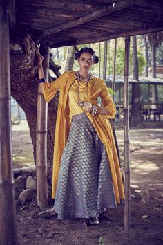 Amoh by JADE. Contemporary mustard hued jacket style kurta,woven in Banarasi handloom paired with brocade palazzo pants