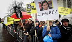 """Amnesty International staging a protest demanding the  release of Saudi blogger Raif Badawi in The Hague, the Netherlands. The Department of Foreign Affairs  said the """"nature and severity"""" of the penalty   is a """"cause of concern"""". Photograph: Martijn Beekman/EPA ("""" Mr Badawi was sentenced to 50 lashes every Friday for 20 weeks as part of a sentence which includes a 10-year jail term, a media and travel ban and a fine. He underwent the first set of floggings last Friday outside a mosque in…"""