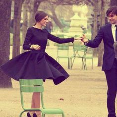 Beautiful picture.  Beautiful dress.  Full skirt perfect for a dance in a Parisian park.  :)