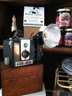 Brownie Camera with a flash!!!  We have so many vintage cameras to choose from at DeeDee's Jewelry & Vintage Decor.