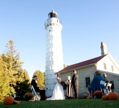 Your wedding with the backdrop of the scenic Cana Island Lighthouse in Door County! Photography by Avenson Photography.