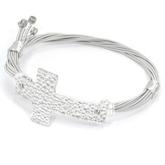 Cross Guitar String Bracelet (8 Inches). Handmade in the USA - made in and ships from Vero Beach, Florida. Guitar String Bracelet by Kona Stacking Bracelets. Genuine Silver Tone Guitar Strings. Cross Bracelet is available in multiple sizes. Ships within 24 hours.