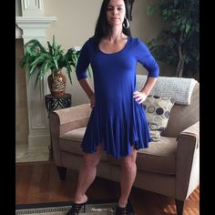 1HR SALE.  FLARED SKIRT TUNIC DRESS BLUE - MED Super soft, yet well constructed; dress it up or down; wear as dress or tunic over tights/leggings/jeans.  Available in 3 colors : BURGUNDY, BLACK, ROYAL BLUE. Sizes: S/M/L  95/5 Rayon/Spandex, Length is 34 inches long, made in USA. price is FIRM, unless bundled. NO TRADES. This listing is for a MEDIUM in BLUE Rouge Dresses High Low