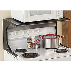 Genius.  A microwave shelf that can be attached to a stove to free up counter space.