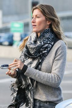 Street style: The 36-year-old's wavy brown hair cascaded freely over the intricately patterned black, grey and white scarf she'd draped round her neck