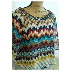 Boho Tribal Top This is a boho style lightweight top with a slight sheerness.  It is a polyester material and is a size Medium.  The label is About a girl. About a girl Tops