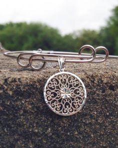 Our latest crush is our Meeting Street Gate in Sterling silver on the expandable charm bangle also made of Sterling silver. Order online or in store!