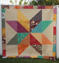 Giant Indie Star Quilt with link to Jeni Baker's Giant Star tutorial (fabric is Pat Bravo's Indie collection and the background fabric is Quilter's Linen) | Diary of a Quilter