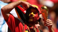 A Belgium #BEL fan holds a replica of the World Cup trophy during the 2014 FIFA #WorldCup Brazil Quarter Final match between #ARGvsBEL at Estadio Nacional on July 5, 2014 in Brasilia, Brazil. (Photo by Clive Rose/Getty Images)