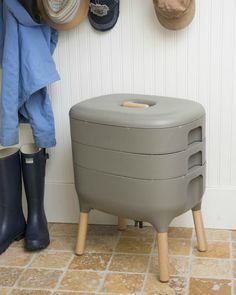 Composting grey worm farm composter pictured in a mudroom or entryway near boots and a coat rack - Attractive kit for making your own worm compost Worm Composting, Compost Tea, Kitchen Compost Bin, Composting Toilet, Urban Composting, Compost Soil, Garden Compost, Bokashi, Growing Vegetables