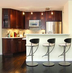 A small contemporary kitchen with dining bar. Great for city & condo living.