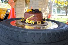 Smash cake  BLATANT BORROWER: First Birthday - Construction Party (cake set on real tire)