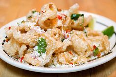 Housemade space-agey pork rinds, starting out as stamp-sized pork fat matter, are topped with cilantro, fresh jalapenos, queso blanco (cheese), and chopped red onion. These might be the most seriously delicious pork rinds ever, and they're not too messy to eat while bowling.  // #BlueRibbonFood - #BrooklynBowlFood - #Food - #NYCRestaurants - #BowlingAlley - #BrooklynFoodPlaces - #NYC -#BrooklynNightLife - #Williamsburg -#Entertainment - #LiveMusic
