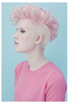 Women's HairCut Short w/Shaved Sides Disconnected Medium Length MoHawk  Women's HairColor Blonde Sides w/Light Pink Top  Women's Style Medium Length MoHawk w/ Loose Curls