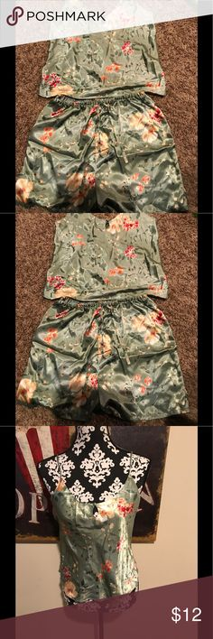 Inner most 2 piece pj sett. Size small Silky feeling 2 piece pajama set. It has a cami top with a key hole embellishment and shorts with a tie waist  The top measures about 15 inches from top to bottom and the shorts measure about 15.5 inches from top to bottom Both are size small 100% polyester inner most Intimates & Sleepwear Pajamas