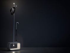 Lucciola is an integrated hat, coat and umbrella stand. Lights illuminate the tips like fireflies, and a blending of cement and iron in its construction